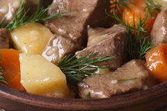 Beef stew with vegetables and dill in a pot macro. Royalty Free Stock Photo