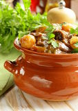 Beef stew with vegetables and herbs in a clay pot Stock Image