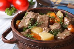 Beef stew with vegetables in a pot horizontal. Stock Photography