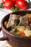 Beef stew with vegetables in a pot vertical Royalty Free Stock Image