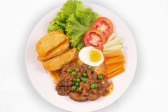 Beef stew with wedges potato, boiled eggs, cucumber, carrot, lettuce, and tomato. In white background Royalty Free Stock Photography