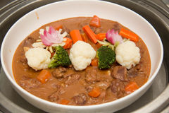 Beef stew in a white crock pot Royalty Free Stock Photography