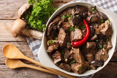 Beef stew with wild mushrooms, onion and chili pepper close up i Stock Photo