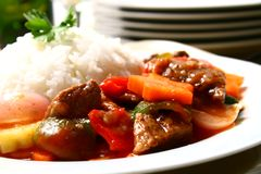 Beef stewed. A serving of beef stewed in tomato sauce stock photos