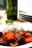 Beef stewed. A serving of beef stewed in tomato sauce with rice stock image