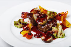 Beef stewed with vegetables and sauce on round plate on white ba Royalty Free Stock Image