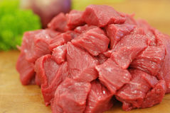 Beef Stewing Steak. On Butcher's Block Royalty Free Stock Photos