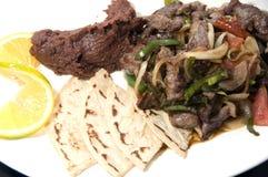 Beef stir fry beans tamales Nicaragua Stock Image