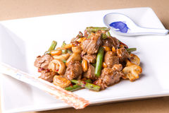 Beef stir fry with chopsticks and spoon Stock Photo