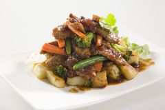 Beef Stir Fry with potatoes. Served on white plate Royalty Free Stock Image