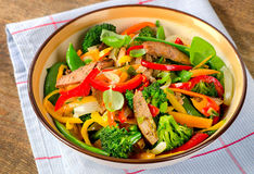 Beef stir fry with vegetables and herbs. Stock Photography