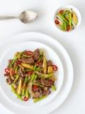 Beef stirfry, studio shot. Beef stirfry, chinese cusine - studio shot stock photography