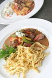 Beef Stroganoff or Beef-Stroganov. Is a Russian dish of sautéed pieces of beef served in a sauce with sour cream Stock Photos