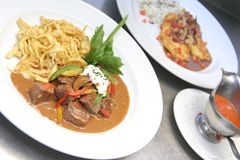 Beef Stroganoff or Beef-Stroganov. Is a Russian dish of sautéed pieces of beef served in a sauce with sour cream Royalty Free Stock Images