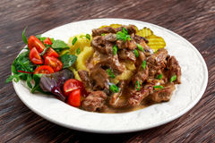 Beef Stroganoff with mashed potatoes and some vegetables. Royalty Free Stock Photos