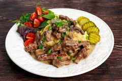 Beef Stroganoff with mashed potatoes and some vegetables. Stock Image