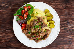 Beef Stroganoff with mashed potatoes and some vegetables. Royalty Free Stock Images