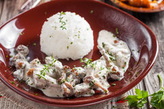 Beef Stroganoff with mushrooms and rice. Russian kitchen Stock Photo