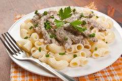 Beef Stroganoff with pasta Stock Photography