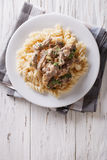 Beef stroganoff with pasta fusilli . Vertical top view Stock Image