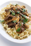 Beef stroganoff with pasta, russian cuisine Royalty Free Stock Photos