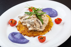 Beef Stroganoff on a potato pancake with sauce Stock Photo