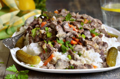 Beef Stroganoff with rice garnish. Stock Photography