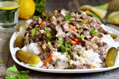 Beef Stroganoff with rice garnish. Royalty Free Stock Photography