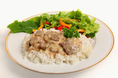Beef stroganoff with salad Royalty Free Stock Images
