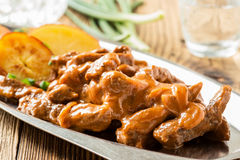 Beef Stroganoff, strips of beef in sour cream served with crisp Royalty Free Stock Photo