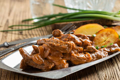 Beef Stroganoff, strips of beef in sour cream served with crisp Royalty Free Stock Photography