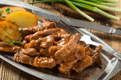 Beef Stroganoff, strips of beef in sour cream served with crisp Stock Photography