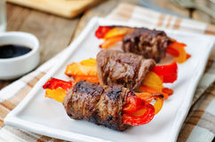 Beef stuffed peppers, carrots and onions with balsamic dressing Stock Photo