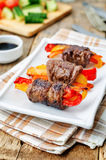 Beef stuffed peppers, carrots and onions with balsamic dressing Stock Photos