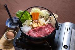 Beef Sukiyaki. Beef slices in sukiyaki hot pot Royalty Free Stock Photography