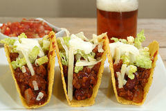 Beef tacos with salsa dip. Three minced beef tacos with salsa dip stock images