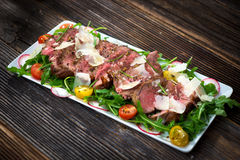 Beef Tagliata with Arugula stock photos
