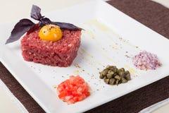 Beef tartar with egg Stock Photos