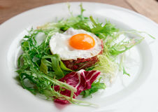 Beef tartar with fried egg Royalty Free Stock Image