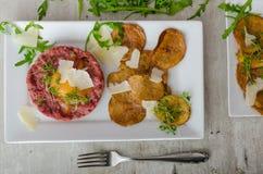 Beef tartar, potato chips Royalty Free Stock Photos
