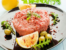 Beef tartar with spices Royalty Free Stock Image