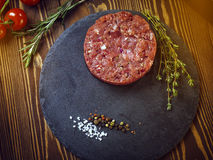 Beef tartar on a stone plate. royalty free stock image