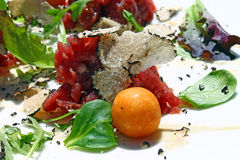 Beef tartare with black truffle Royalty Free Stock Images