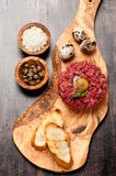 Beef tartare with capers, egg and onion Stock Images