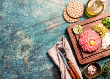 Beef tartare on cutting board Royalty Free Stock Image