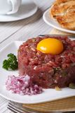 Beef tartare with egg and vegetables closeup.  Vertical Royalty Free Stock Photos