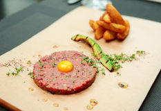 Beef tartare with french fries and avocado Royalty Free Stock Photo