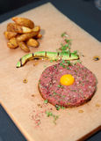 Beef tartare with french fries and avocado Stock Photo