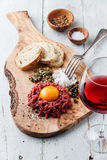Beef tartare on olive wood board Royalty Free Stock Photos