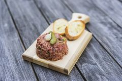 Beef tartare with pickle and crouton Stock Photos